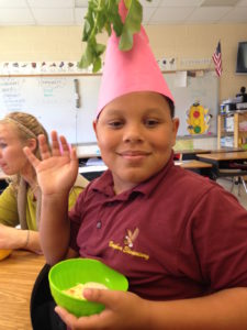 Leroy, dressed as a radish -- sharing his newfound veggie love. Image: FoodCorps North Carolina
