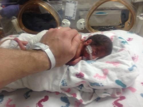 Image: Brent Garber - Baby Caroline with Daddy's comforting hand.