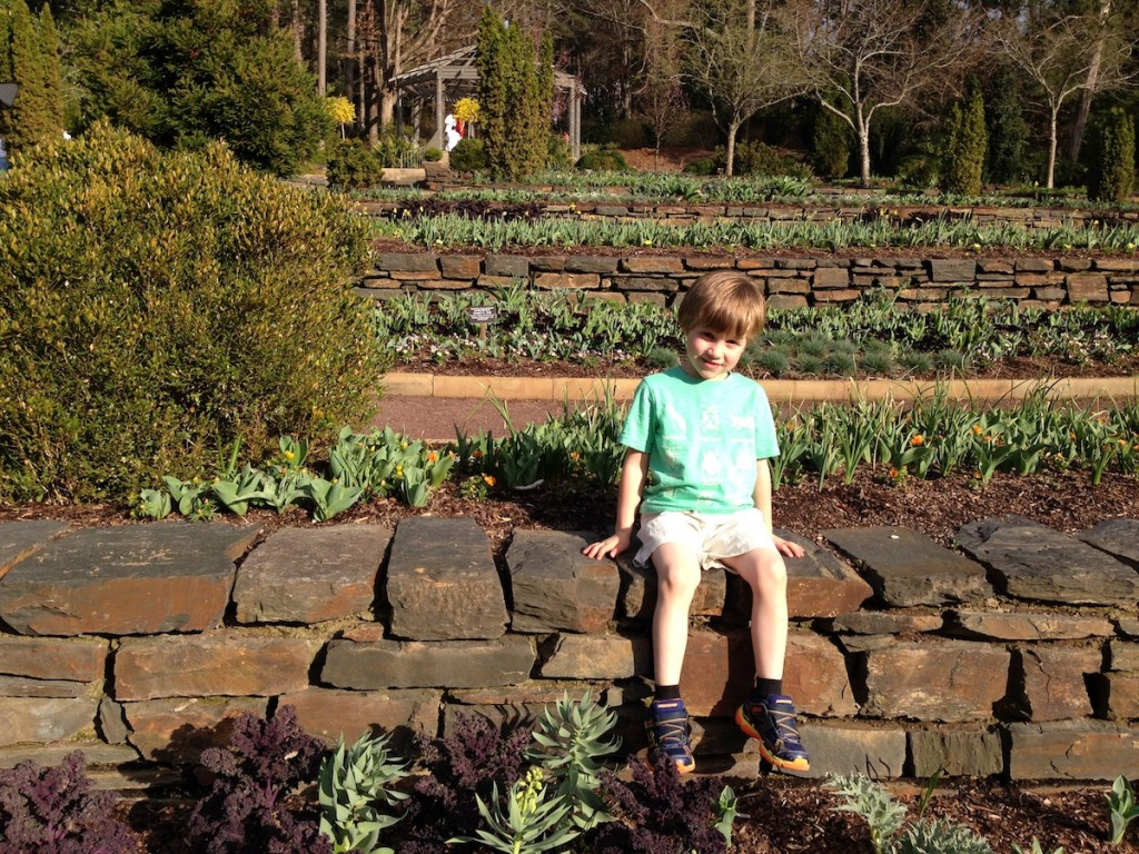 The author's son striking a pose at Duke Gardens.