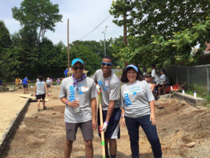 Pictured: Robin Miller volunteers at a KaBoom event with fellow employees!