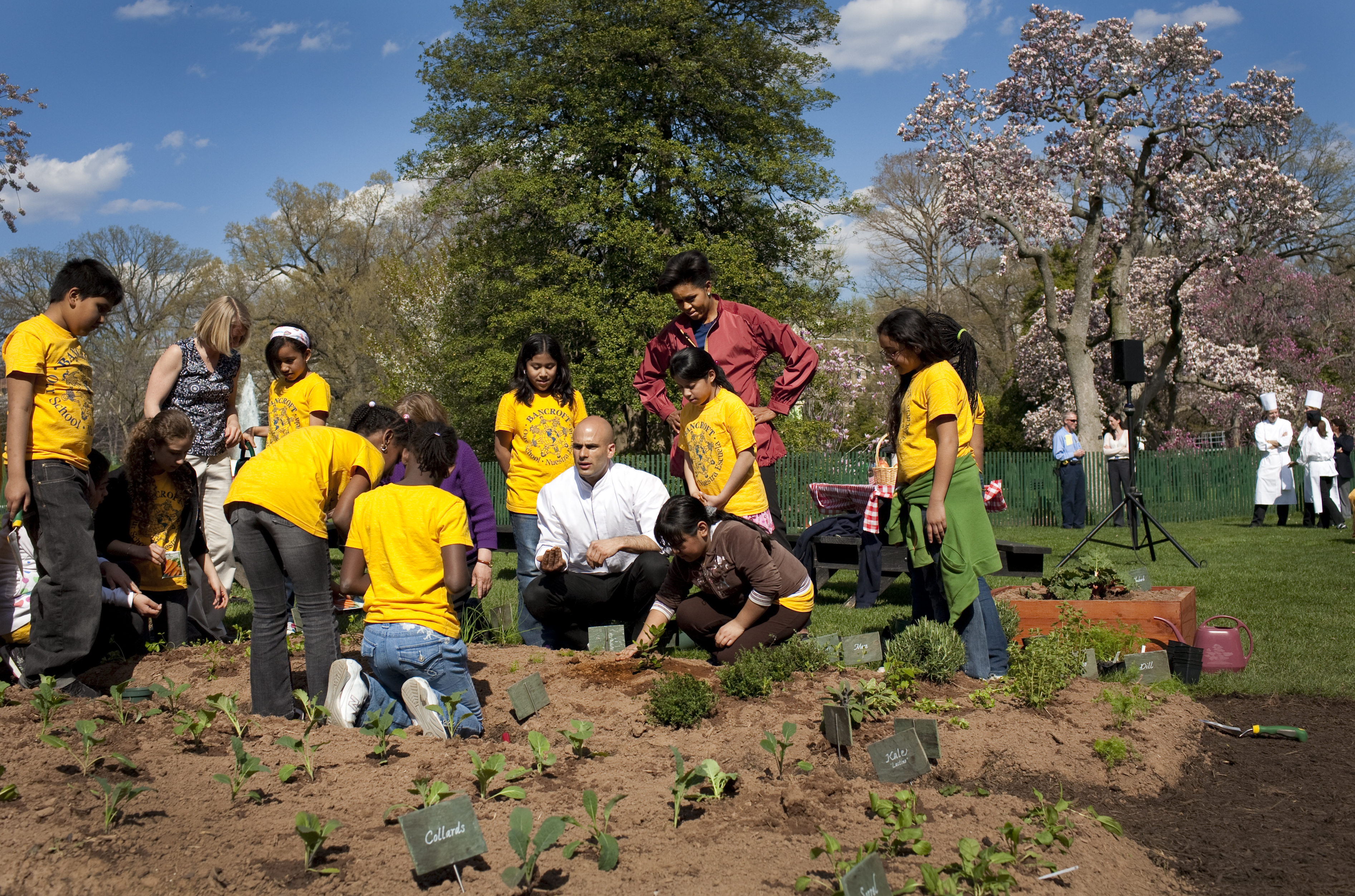 Children from the Bancroft school help First Lady Michelle Obama plant the White House Vegetable Garden. Official White House Photo by Samantha Appleton