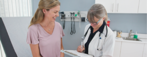 Smiling woman with her primary care doctor