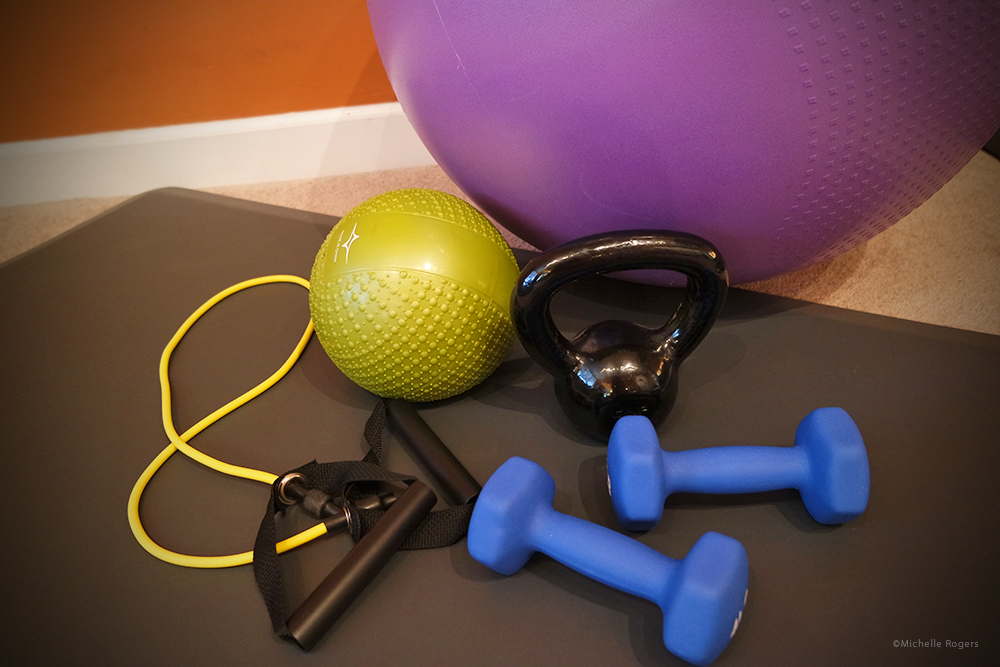 Stability ball, weighted ball, kettlebell, resistance band, dumbbells, exercise mat.