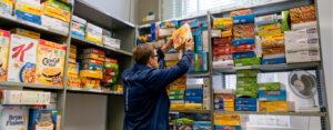 Man stocks shelves at food bank