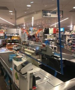 Plastic shields in grocery store to protect essential workers