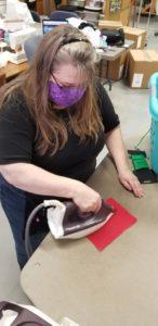 woman irons mask
