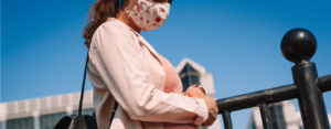 pregnant woman wearing a mask