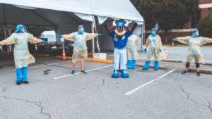 Durham Bulls Mascot poses with healthcare workers in gowns and masks