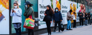 People in masks social distancing in NYC
