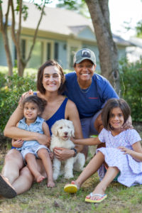 Alicia Stokes with her wife, two daughters, and their puppy