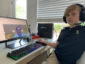 little boy at virtual school workstation