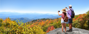 Father and daughter hiking take pictures of scenic overlook