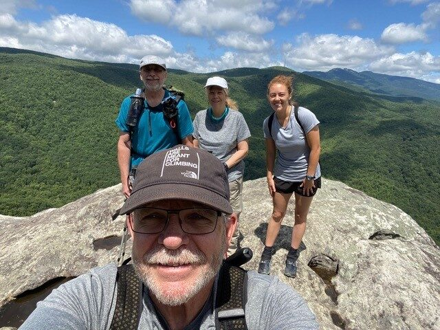 Joe Miller and three other hikers at a lookout point