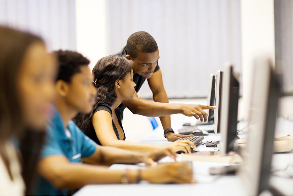 Black students study together in computer lab