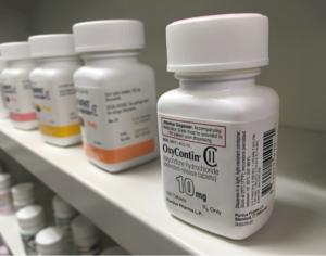 OxyContin pill bottles on pharmacy shelf