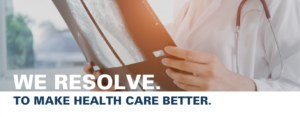 """Doctor holds scan from mammogram. Text overlay reads """"We resolve to make health care better."""""""
