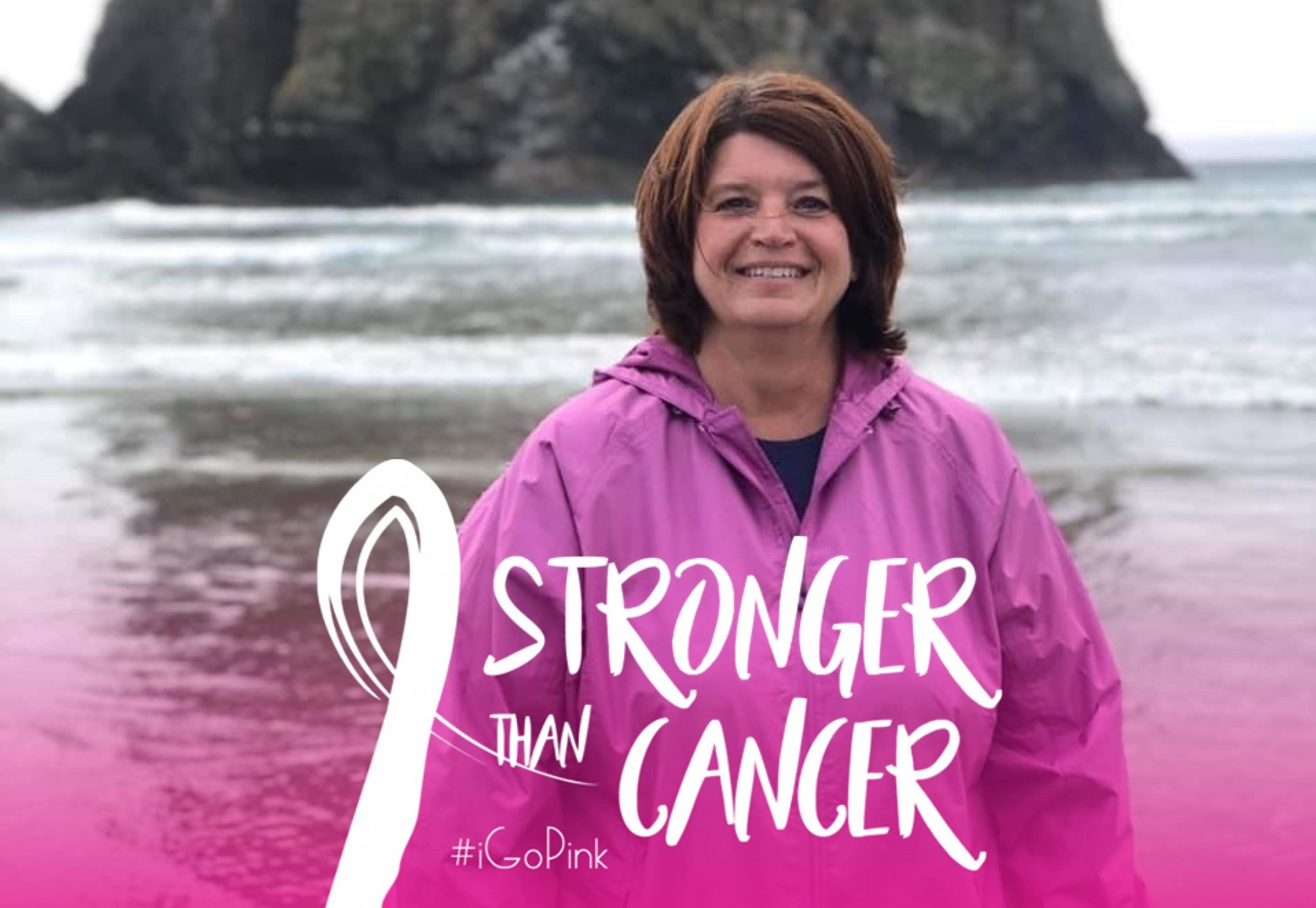 "Laura smiling in front of the ocean. Text overlay shows a cancer ribbon with the words ""stronger than cancer."""