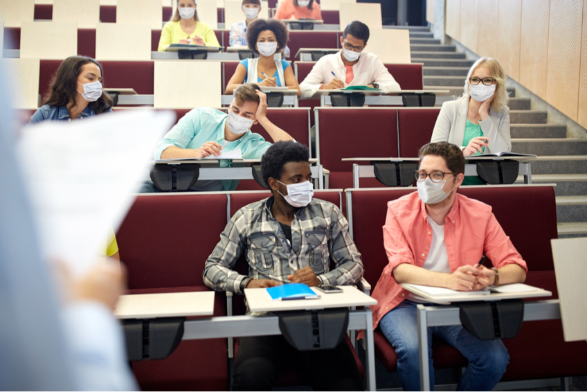 College students in lecture hall wear face masks
