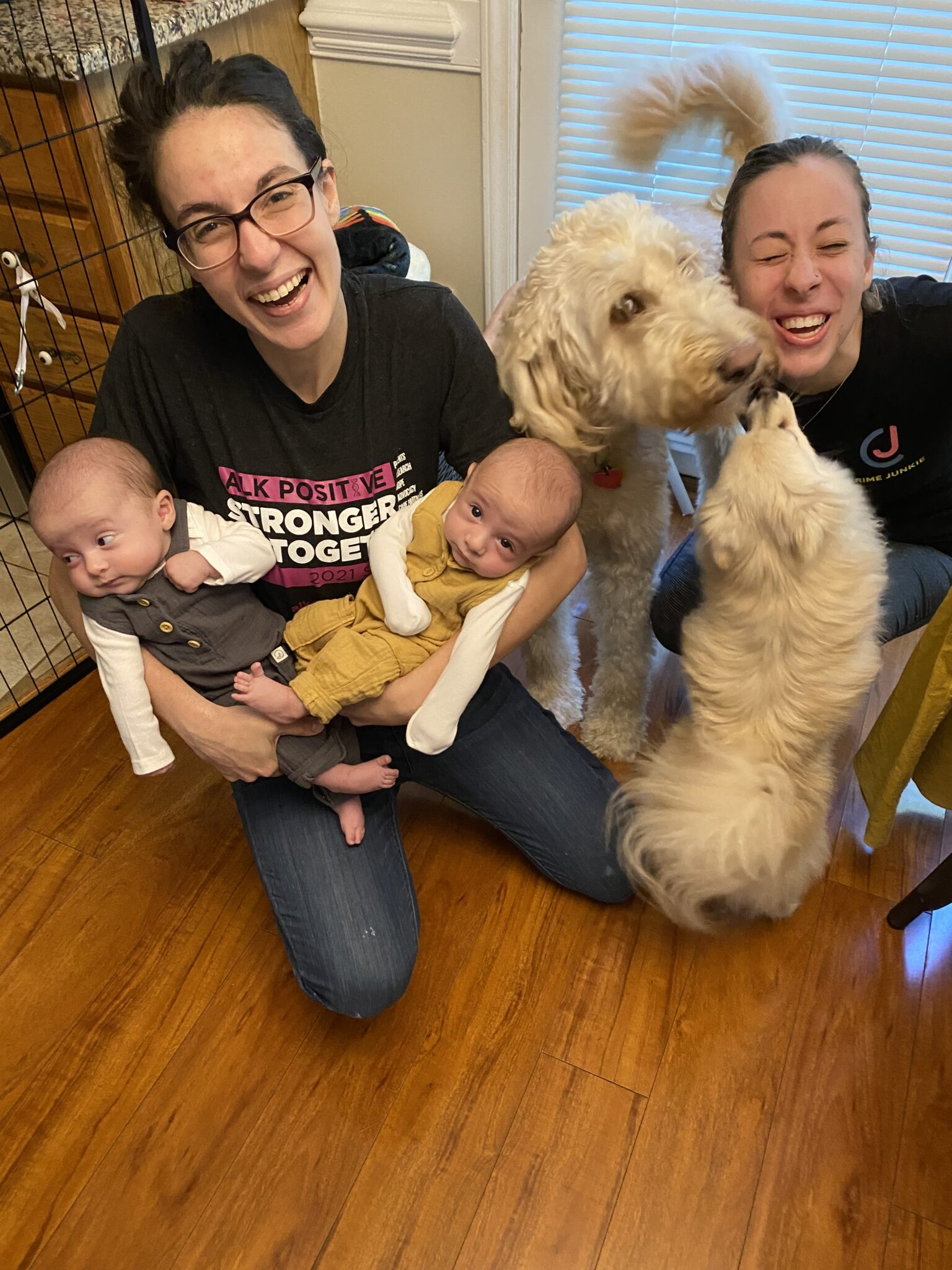 Venelina, Lindsay, and the babies crouch down with their two dogs