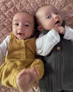 The twins look into the camera