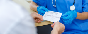 Doctor holds vaccination card